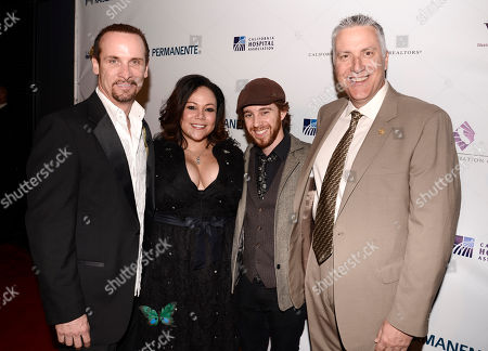 Stock Picture of Colin Cunningham, and from left, Mela Lee and Alexander Burke of the musical group Magnolia Memoirs, and Charirman of the California Fire Foundation Lou Paulson arrive at the 2nd Annual California Fire Foundation Gala at Avalon Hollywood, in Hollywood, Calif