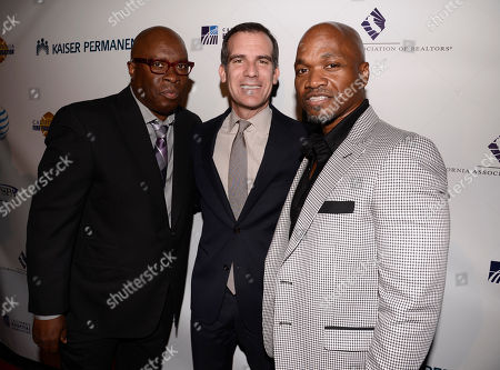 Vince Wilburn Jr., and from left, Los Angeles Mayor Eric Garcetti, and Jesse Campbell arrive at the 2nd Annual California Fire Foundation Gala at Avalon Hollywood, in Hollywood, Calif
