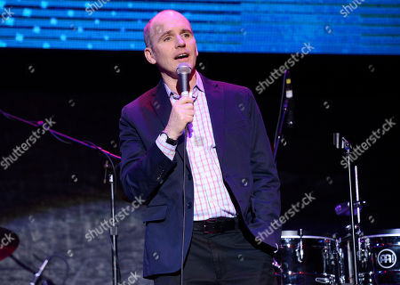 Greg Fitzsimmons speaks on stage at the 2nd Annual California Fire Foundation Gala at Avalon Hollywood, in Hollywood, Calif