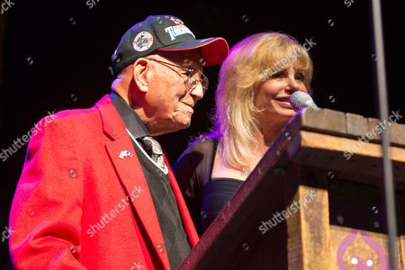Actress Loni Anderson receives the Millie Taylor award from Lt. Col. Bob Friend, the oldest living Tuskegee Airman, during the 2nd Annual Heroes Helping Heroes Benefit Concert at The House of Blues on in Los Angeles