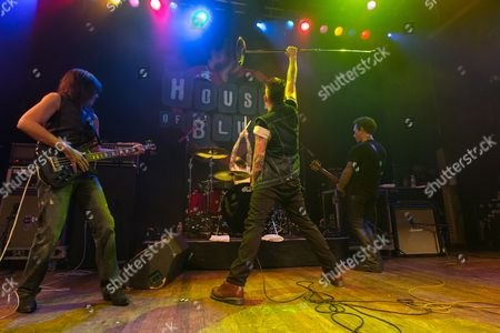 Bassist Rudy Sarzo, vocalist Mark McGrath, and guitarist Billy Morrison perform on stage at the 2nd Annual Heroes Helping Heroes Benefit Concert at The House of Blues on in Los Angeles
