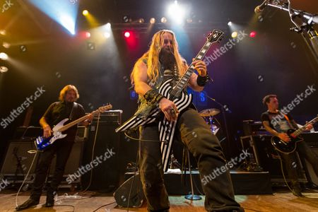 Bassist Geezer Butler, drummer Tommy Clufetos, and guitarist Zakk Wylde perform on stage at the 2nd Annual Heroes Helping Heroes Benefit Concert at The House of Blues on in Los Angeles
