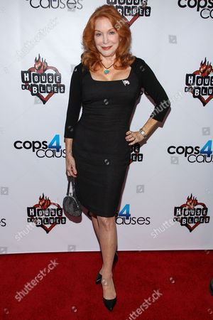 Stock Image of Actress Sondra Currie arrives at the 2nd Annual Heroes Helping Heroes Benefit Concert at The House of Blues on in Los Angeles