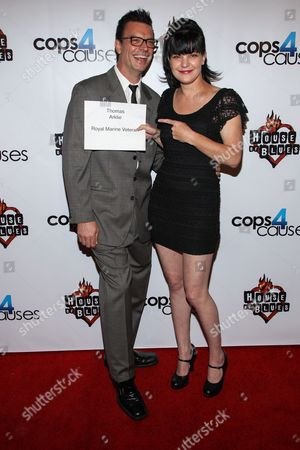 Actress Pauley Perrette and fiance Thomas Arklie arrive at the 2nd Annual Heroes Helping Heroes Benefit Concert at The House of Blues on in Los Angeles
