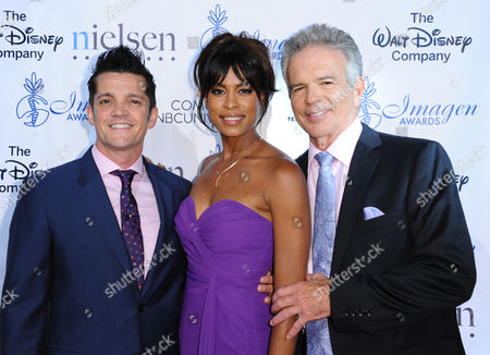 Jonathan Del Arco, from left, Kearran Giovanni and Tony Denison arrive at the 30th annual Imagen Awards at the Dorothy Chandler Pavilion, in Los Angeles