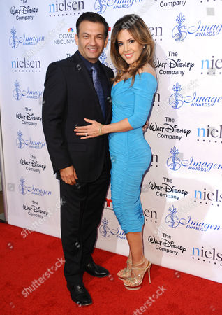 David Barrera, left, and Maria Canals-Barrera arrive at the 30th annual Imagen Awards at the Dorothy Chandler Pavilion, in Los Angeles