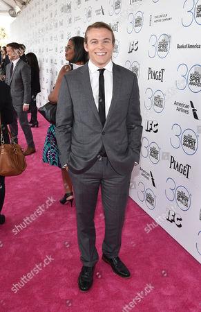 Jordan Christian Hearn arrives at the 30th Film Independent Spirit Awards, in Santa Monica, Calif