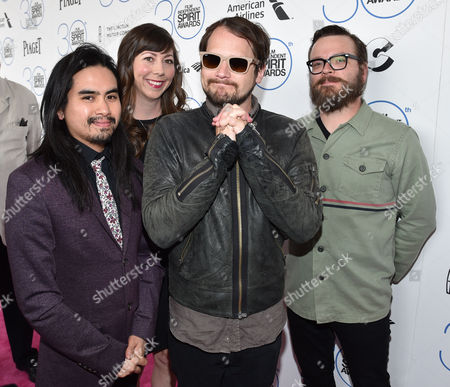 "Christopher Guanlao, from left, Nikki Monninger, Brian Aubert, and Joe Lester of the musical group ""Silversun Pickups"" arrive at the 30th annual Film Independent Spirit Awards, in Santa Monica, Calif"
