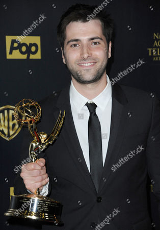 Freddie Smith poses in the pressroom with the award for outstanding younger actor in a drama series at the 42nd annual Daytime Emmy Awards at Warner Bros. Studios, in Burbank, Calif
