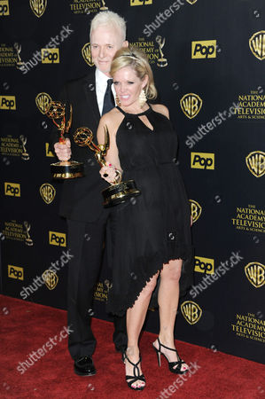 Anthony Geary, left, and Maura West pose in the pressroom with the award for outstanding lead actor and actress in a drama series at the 42nd annual Daytime Emmy Awards at Warner Bros. Studios, in Burbank, Calif