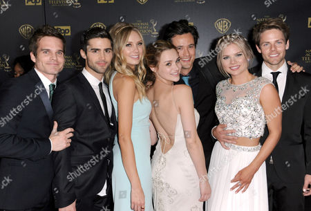 Max Ehrich, from left, Melissa Ordway, Hunter King, Matthew Atkinson, Kelli Goss, and Lachlan Buchanan pose in the pressroom at the 42nd annual Daytime Emmy Awards at Warner Bros. Studios, in Burbank, Calif