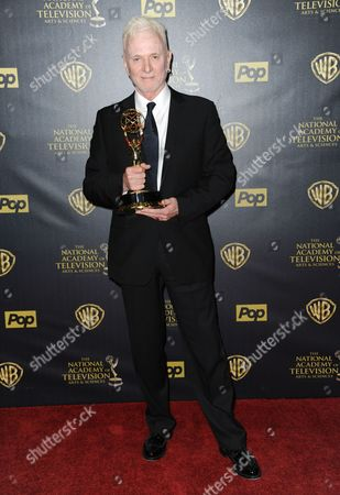 Anthony Geary poses in the pressroom with the award for outstanding lead actor in a drama series at the 42nd annual Daytime Emmy Awards at Warner Bros. Studios, in Burbank, Calif