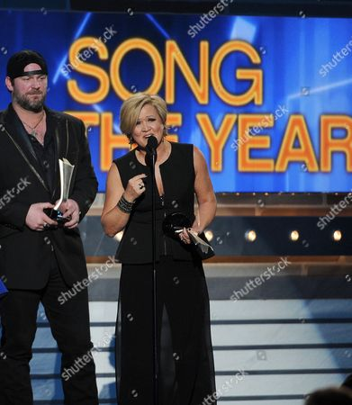 Lee Brice, left, and songwriter Connie Harrington accept the award for song of the year at the 49th annual Academy of Country Music Awards at the MGM Grand Garden Arena, in Las Vegas