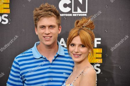 Bella Thorne, right, and Tristan Klier arrive at the 4th Annual Hall of Game Awards on Saturday, Feb, 15, 2014 in Santa Monica, Calif