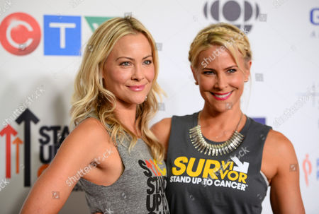 Cynthia Daniel, left, and Brittany Daniel arrive at the 4th Annual Stand Up 2 Cancer Live Benefit at The Dolby Theatre, in Los Angeles