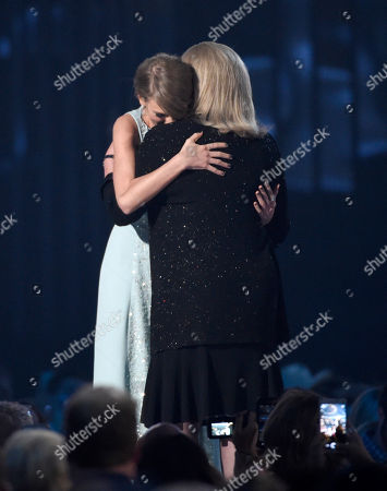 Andrea Finlay, right, presents the milestone award to Taylor Swift at the 50th annual Academy of Country Music Awards at AT&T Stadium, in Arlington, Texas