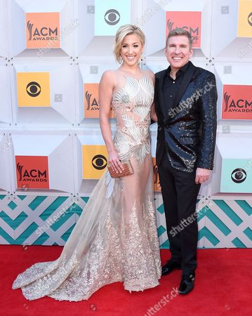 Savannah Chrisley, left, and her father Todd Chrisley arrive at the 51st annual Academy of Country Music Awards at the MGM Grand Garden Arena, in Las Vegas