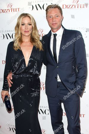 Stock Photo of Christina Applegate, left, and Martyn LeNoble attend The Dizzy Feet Foundation's 5th Annual Celebration of Dance Gala held at Club Nokia, in Los Angeles