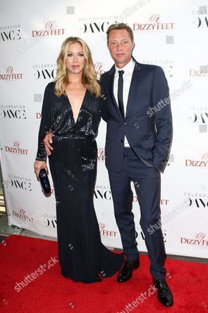 Christina Applegate, left, and Martyn LeNoble attend The Dizzy Feet Foundation's 5th Annual Celebration of Dance Gala held at Club Nokia, in Los Angeles