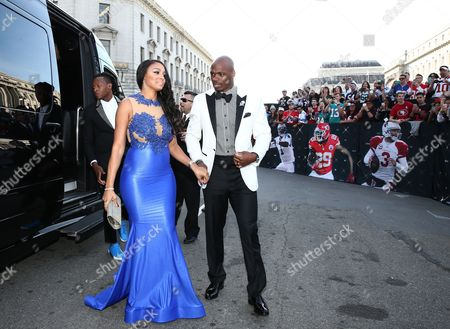 Adrian Peterson of the Minnesota Vikings, right, and Ashley Brown arrive at the 5th annual NFL Honors at the Bill Graham Civic Auditorium, in San Francisco