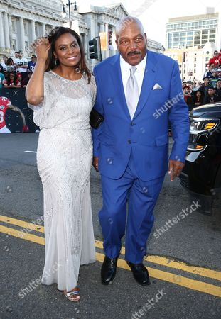Former NFL player Jim Brown, right, and Monique Brown arrive at the 5th annual NFL Honors at the Bill Graham Civic Auditorium, in San Francisco