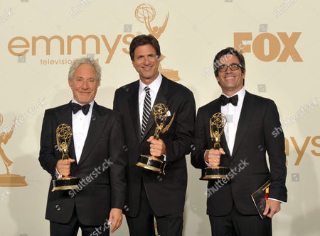 SEPTEMBER 18: (L-R) Steven Levitan, Jeffrey Richman, Michael Spiller poses in the press room at the Academy of Television Arts & Sciences 63rd Primetime Emmy Awards at Nokia Theatre L.A. Live on in Los Angeles, California