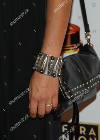 Stock Picture of Actress Natalia Castellanos (bracelet detail) arrives at the 65th Emmy Awards Nomination Celebration at the Academy of Television Arts and Sciences on in North Hollywood, California