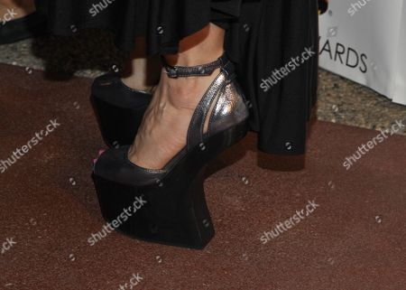 Actress Megan Duffy (shoe detail) arrives at the 65th Emmy Awards Nomination Celebration at the Academy of Television Arts and Sciences on in North Hollywood, California