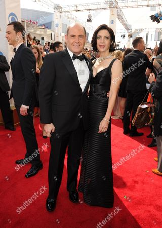From left, Matt Weiner and Linda Brettler arrive at the 65th Primetime Emmy Awards at Nokia Theatre, in Los Angeles