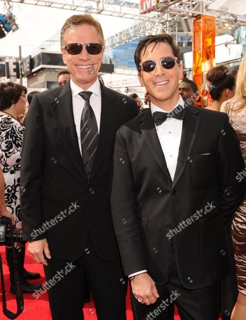 From left, Don Roos and Dan Bucatinsky arrive at the 65th Primetime Emmy Awards at Nokia Theatre, in Los Angeles