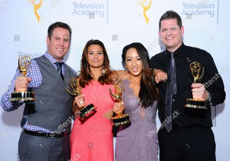 "Members of KTLA5, Nick Simpson, from left, Madelaine Hahn, Angel Kim, and Jason Roberts pose for a portrait with the award for light news story - single report for ""Ghost Bike"" at the 67th Los Angeles Area Emmy Awards at the Skirball Cultural Center on"