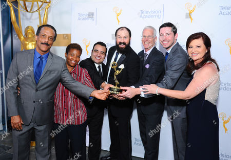 """NBC4 News Team, Kevin LaBeach, from left, Susan Monroe, Mekahlo Medina, Joel Cook, Patrick Healy, Eric Shackelford and Yvonne Guevara pose for a portrait with the award for news special for """"Napa Quake"""" at the 67th Los Angeles Area Emmy Awards at the Skirball Cultural Center on"""