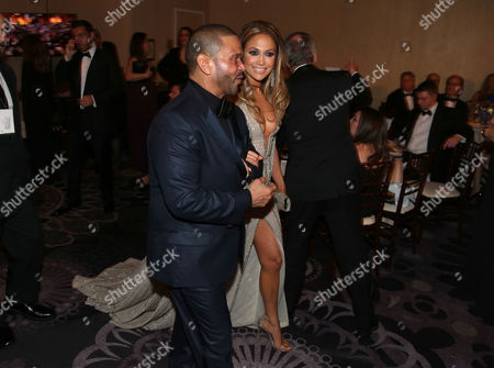Benny Medina, left, and Jennifer Lopez walk in the audience at the 72nd annual Golden Globe Awards at the Beverly Hilton Hotel, in Beverly Hills, Calif