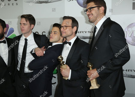 """Martin Wallstrom, from let, Rami Malek, Christian Slater and writer/producer Sam Esmail pose with the award for best series - drama for """"Mr. Robot,"""" at the NBCUniversal Golden Globes afterparty, at the Beverly Hilton Hotel in Beverly Hills, Calif"""