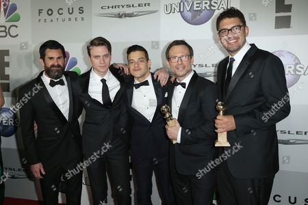 """Producer Chad Hamilton, from left, Martin Wallstrom, Rami Malek, Christian Slater and writer/producer Sam Esmail pose with the award for best series - drama for """"Mr. Robot,"""" at the NBCUniversal Golden Globes afterparty, at the Beverly Hilton Hotel in Beverly Hills, Calif"""