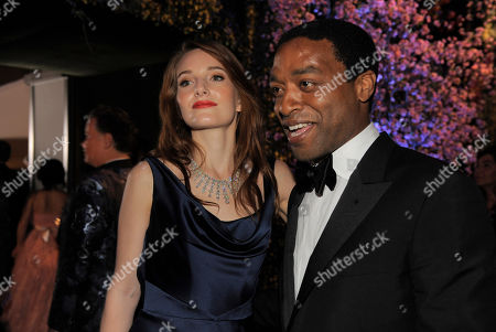 Sari Mercer, left, and Chiwetel Ejiofor attend the Governors Ball after the Oscars, at the Dolby Theatre in Los Angeles