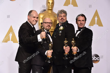Paul Franklin, and from left, Andrew Lockley, Ian Hunter and Scott Fisher pose in the press room with the award for best visual effects for their work on Interstellar at the Oscars, at the Dolby Theatre in Los Angeles