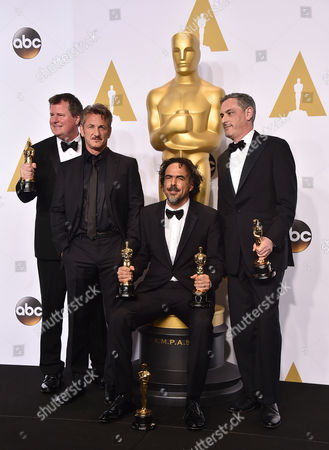 "James W. Skotchdopole, from left, Sean Penn, Alejandro Gonzalez Inarritu and John Lesher pose in the press room with the awards for best picture and best director for Birdman"" at the Oscars, at the Dolby Theatre in Los Angeles"