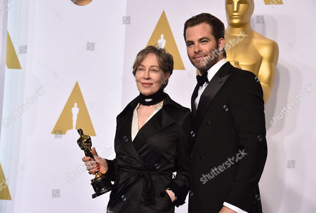 Milena Canonero, left, and Chris Pine pose in the press room with her award for best costume design for The Grand Budapest Hotel at the Oscars, at the Dolby Theatre in Los Angeles