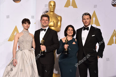 Felicity Jones, and from left, Adam Stockhausen, Anna Pinnock and Chris Pratt pose in the press room with the award for best production design for The Grand Budapest Hotel at the Oscars, at the Dolby Theatre in Los Angeles