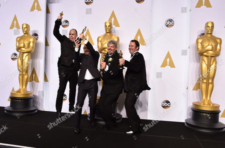 Paul Franklin, from left, Andrew Lockley, Ian Hunter and Scott Fisher pose in the press room with the award for best visual effects for their work on Interstellar at the Oscars, at the Dolby Theatre in Los Angeles