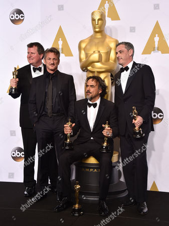 "James W. Skotchdopole, and from left, Sean Penn, Alejandro Gonzalez Inarritu and John Lesher pose in the press room with the awards for best picture and best director for Birdman"" at the Oscars, at the Dolby Theatre in Los Angeles"