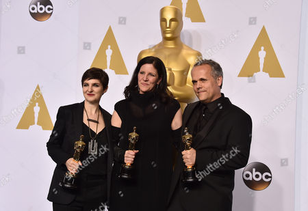 Mathilde Bonnefoy, and from left, Laura Poitras and Dirk Wilutzky pose in the press room with the award for best documentary feature for their work on Citizenfour at the Oscars, at the Dolby Theatre in Los Angeles