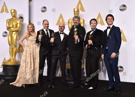 Chloe Grace Moretz, from left, Paul Franklin, Andrew Lockley, Ian Hunter, Scott Fisher and Ansel Elgort pose in the press room with the award for best visual effects for Interstellar at the Oscars, at the Dolby Theatre in Los Angeles