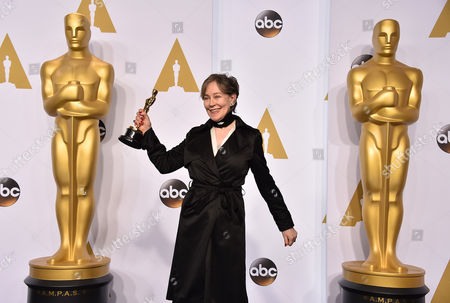 Milena Canonero poses in the press room with her award for best costume design for The Grand Budapest Hotel at the Oscars, at the Dolby Theatre in Los Angeles