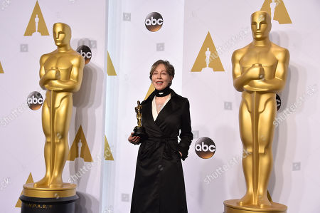 Milena Canonero poses in the press room with her award for best costume design for â?oeThe Grand Budapest Hotelâ?? at the Oscars, at the Dolby Theatre in Los Angeles