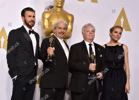 Chris Evans, and from left, Alan Robert Murray, Bub Asman and Sienna Miller pose in the press room with the award for best sound editing for American Sniper at the Oscars, at the Dolby Theatre in Los Angeles
