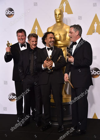 "James W. Skotchdopole, and from left, Sean Penn, Alejandro Gonzalez Inarritu and John Lesher pose in the press room with the awards for best original screenplay, best director and best picture for Birdman"" at the Oscars, at the Dolby Theatre in Los Angeles"