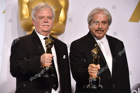 Bub Asman, left, and Alan Robert Murray pose in the press room with the award for best sound editing for American Sniper at the Oscars, at the Dolby Theatre in Los Angeles