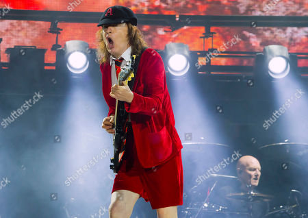AC/DC's Angus Young, left, and Chris Slade perform during their Rock Or Bust World Tour at Gillette Stadium on in Foxborough, Mass